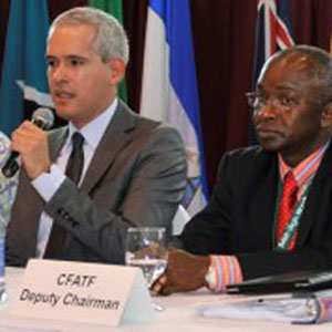 Chairman Manuel Gonzalez passes The Baton of Leadership to Chairman Cherno Jallow at CFATF Plenary Meeting XXXVI